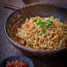 Indonesian stir fried noodles. With veggies, seafood, or meat.