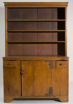 """New England Stepback Pewter Cupboard, New England Stepback Pewter Cupboard,  late 18th c., pine, four open shelves with applied molded edges, single hinged door flanked by two short drawers, straight bracket foot base with front facing. 77"""" x 48"""" x 19"""""""