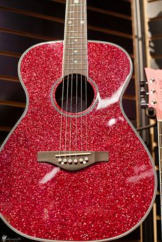 This sparkly guitar is gorgeous, I would love to play it.