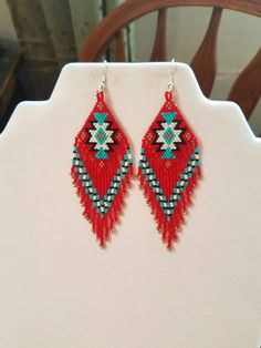 Earrings In Style - Beautiful Native American Style Beaded Rug Earrings in Black, White, Red and Turquoise and Copper. They are 4 inch long and 1 inch wide. If you like these but would like other Colors just email me. Native Beading Patterns, Beadwork Designs, Seed Bead Patterns, Loom Patterns, Indian Beadwork, Native American Beadwork, Native American Fashion, Native American Earrings, Native Beadwork