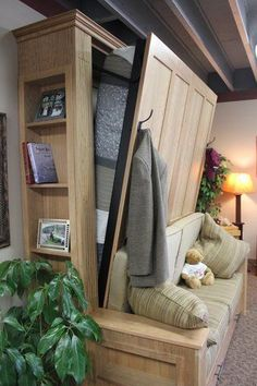 Another great tiny house solution for extra guest. Murphy Bed and sofa in one for the yurt -- Montana Murphy Beds: