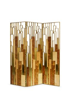 DELPHI SCREEN | BRABBU is a geometric 3 panel folding screen. This perfect screen room divider is made with elm root wood and with a brass aged patina finish.