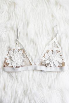 "- Details - Size - Shipping - • 100% Polyester • Floral aplique bralette with adjustable straps and waist • Hand Wash • Line dry • Imported • Measured from small • Length 9.5"" • Chest 12.5"" - Free dom"