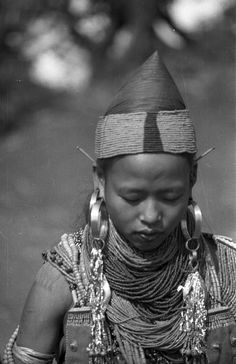 India | Ngapun of the Ang clan dressed up with elaborate jewellery. Preparation for O-ya-bu or Spring festival. Longkhai, Nagaland, Mon District. 1937. | ©SOAS, Nicholas Haimendorf