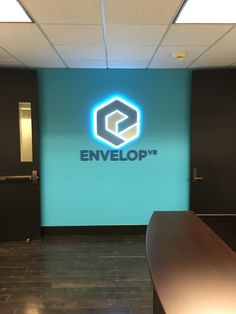 NW Signs - ENVELOP VR - illuminated branding displayed at  entry of offices. (Design by Signs of Seattle)