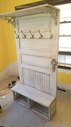 Up cycled door. Two crates on the bottom and shelf on the top.