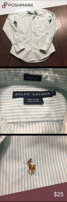 Ralph Lauren Button Down Size 0 slim fit. Seems true to size- would fit a 00 or 0. All buttons in place and no flaws. Pretty pale blue stripes. Excellent used condition, worn twice maybe. Ralph Lauren Tops Button Down Shirts