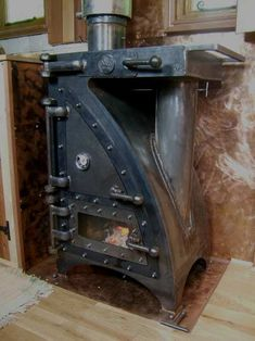 The Anvil.A Multifuel Stove / Range which can cook, bake, smoke fish etc and heat water. Old Stove, Stove Oven, Pellet Stove, Rocket Mass Heater, Stove Fireplace, Rocket Stoves, Wood Burner, Welding Projects, Log Homes