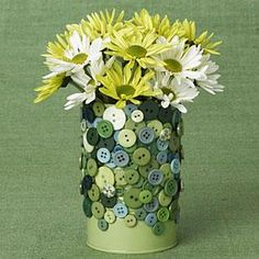 Paint and glue buttons to tin cans to dress them up and the hang on peg board for Organization.