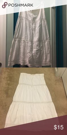 Women's maxi skirt Women's maxi skirt. It's is a cream color. It has some crochet designs throughout the skirt, ties at the waist and has an under layer so it's not see through. Roxy Skirts Maxi