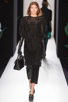 A fresh (and warm!) approach to winter evening dress. Love the severity of the long black leather gloves mixed with the unashamed prettiness of the lace tunic. Mulberry, A/W 2013/14.