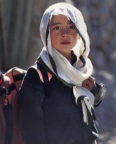 «Photo by @alisonwrightphoto // This school girl in Gulmit, Hunza Valley, Pakistan passed me while hiking in the remote mountainous region along the…»