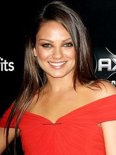 Looking to wear your hair long and loose for prom? Take a cue from these celebs and get gorgeous strands that stand out. Mirror-like, silky straight tresses like Mila Kunis' may look relatively understated but are super gorgeous and so polished for a big night like prom. Apply a heat protecting spray before blowing your hair dry, then flat iron to get your hair as straight as possibly. Follow with a shine serum.