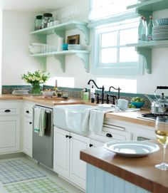 Love the farmhouse sink and fixtures, butcher block countertops and beautiful open shelving