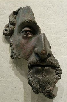 Roman bronze fragment, Louvre. Only half a face but in it you see the whole