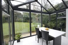 Interior of black upvc conservatory with glass roof.  Pair of french doors. Modern and contemporary.