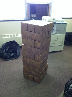 DIY: Giant Jenga Lighter weight; made from fridge size soda boxes and contact paper. We could look into this as a way to do Jenga at Kickoff or with with younger kids around...