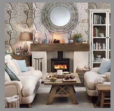 bold rustic wallpaper as accent   ... sofas upholstered in french linens, with rustic burnt oak accents