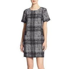 SOLD! Banana Republic Black & White Shift Dress Size: 0. Length: Approximately 35 inches. Approximately 16 inches from armpit to armpit. Waist: Approximately 32 inches. Black and white plaid print. Pockets with faux ( fake) leather trim. Lined. 65% acrylic, 35% polyester. Lining is 100% polyester. Trim is polyurethane. Banana Republic Dresses