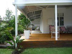 Byron Beach House - lovely garden around the verandah