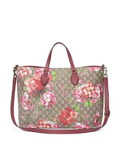 """Gucci blooms-print GG supreme canvas tote bag. Golden hardware and leather trim. Flat top handles, 4.5"""" drop. Removable, adjustable shoulder strap, 19.5"""" drop. Open top with magnetic closure. Interior"""