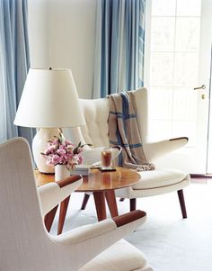 "The pair of midcentury Hans Wegner Papa Bear armchairs flanking a 1940s French table in the master bedroom ""are iconic."""