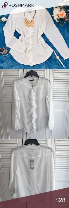 "Tommy Hilfiger Women Long Sleeve Ruffle blouse This women long sleeve ruffle blouse is come in a soft white color with gold stripes. It feature ruffle on the center of the shirt from neckline to bottom. The neck is attach with an button on the front so it can be wear round neck or V-neck. See last picture. Brand new with tag, never wear.  Shoulder to bottom: 23"" Chest: 19.5"" Arm: 24"" Material: 99% Polyester, 1% Metallic  Measurement are base on item lay flat on the floor. Best offer accept…"