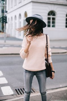 Grey fedora hat with a pink sweater