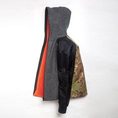 The Griffin Upside Down Jacket back is in an original camouflage fabric from the Italian mill Majocchi; mixed with a super light weight Italian technical nylon with micro ripstop and PU coating on the sleeves. The front and outer hood is made from a traditional wool company Fox Brothers & Co Ltd. The inner 3D mesh fabric by Scheoller is designed to keep you both warm and ventilated. #griffin #menswear #sportswear #fashion #military #british #technology #sustainability #modern #luxury…