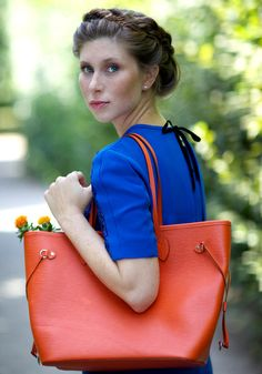 """Still in the gardens of Schönbrunn Palace, Vicky from 'Bikinis and Passports"""" carries the Orange version of the Epi Neverfull ( via @Vicky Lee Heiler )"""