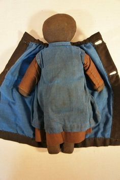 Amish black doll with cloak and kerchief , antique