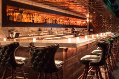 The 21 Most Secret Bars in America- concrete bar with corbels and wood front