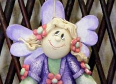 A lovely little salt dough angel which stands 7 inches tall and has a hole for hanging or threading. She has been varnished many times for durability and painted in acrylics.