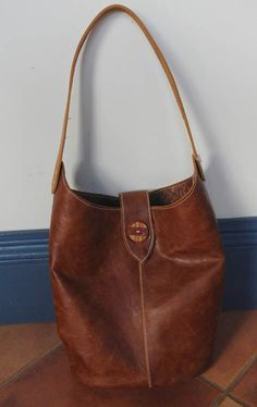 Handmade leather tote bag with antique button. www.flindersshoes.com.au  bag and vest page