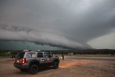 A cylindrical super cell dominates the sky above Seymour, Texas.   Storm chasers are so brave!