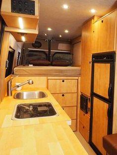 Sprinter interior with maple cabinets and a refrigerator. Van Conversion Layout, Diy Van Conversions, Van Conversion Interior, Sprinter Camper Conversion, Camper Van Conversion Diy, 4x4 Camper Van, Diy Camper, Kombi Motorhome, Rv Homes