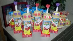 Valentine Robot Snacks for kids...   Glue juice box to raisin box,  Tape smarties on for arms,  Glue on Applesauce for head,  Tape spoon to back of applesauce,  Decorate with hearts, use either hearts or eyeball stickers for eyes.   So Fun!