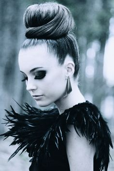 Black Swan Deep dark eyes Crowned with the perfect Top Knot