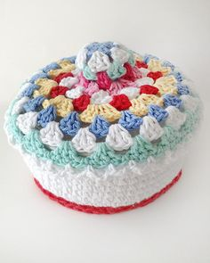 Granny-Go-Round Kitchen Set Crochet Pattern - The NEW Granny-Go-Round Kitchen Set Crochet Pattern is an Easy Skill design that is sure to brighten up your kitchen. Pictured is the Casserole Cover - one of ten designs included. Available only from Maggie's Crochet