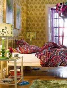 The wallpaper is a bit much for me but the colourful linen and matching light...gorgeous.
