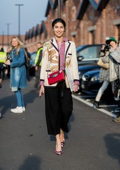 Caroline Issa wearing a Gucci blazer black cropped pants checked button shirtoutside Gucci on February 22 2017 in Milan Italy #MFW #FW17 #StreetStyle