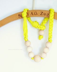 Neon necklace.  Wear it with sporty grey t-shirt?