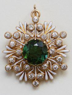 An antique gold, enamel, tourmaline and diamond Snowflake pendant / brooch, USA, circa 1900. Diameter: 3 cm. #antique #brooch #pendant