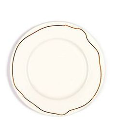 Chain Dinner Plates: Far from the traditional banded dinnerware, this bone china plate is reinvented with a gilded chain that makes the full loop around.