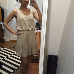 Tan Dress with Pockets. Tan/Taupe color. Pockets on each side. A little drapey on top but still flattering and not too poofy. Hem hits about mid thigh. Worn once. Never been washed. Forever 21 Dresses Mini