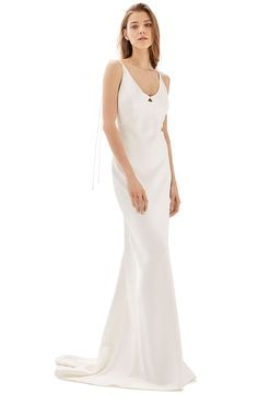 This flowing satin-textured sheath dress brings together classic and laid back wedding gown styles