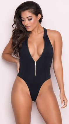 Hit the beach in this exclusive black swimsuit featuring a high neck zipper  closure 36c9bae67e