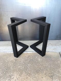 Price is for set of 2 L shape table legs Theyre carefully welded for a clean finish. This can go with a piece of wood slab for a nice finish. Material: -2 x 1 14 Ga. squared steel tube Holes: 5/16 holes on top Finish Options -Raw/ Natural steel (this can rust) -Flat Black -Clear Coat