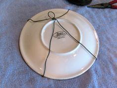 MAY DAYS DIY Wire Plate Hangers More & cheap home improvement   Paper clip Rubber bands and Walls