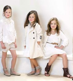 Zara kids white coats.  Yup,  dressing my girls like this